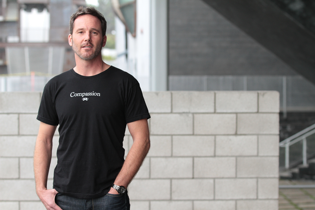 Man wearing black Compassion t-shirt