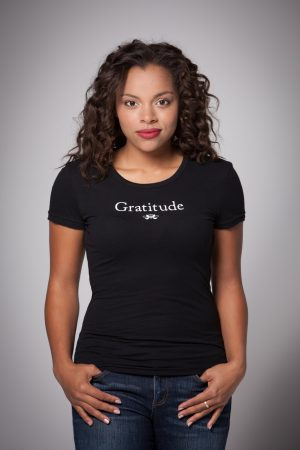 Woman wearing Gratitude Cap Sleeve Tee