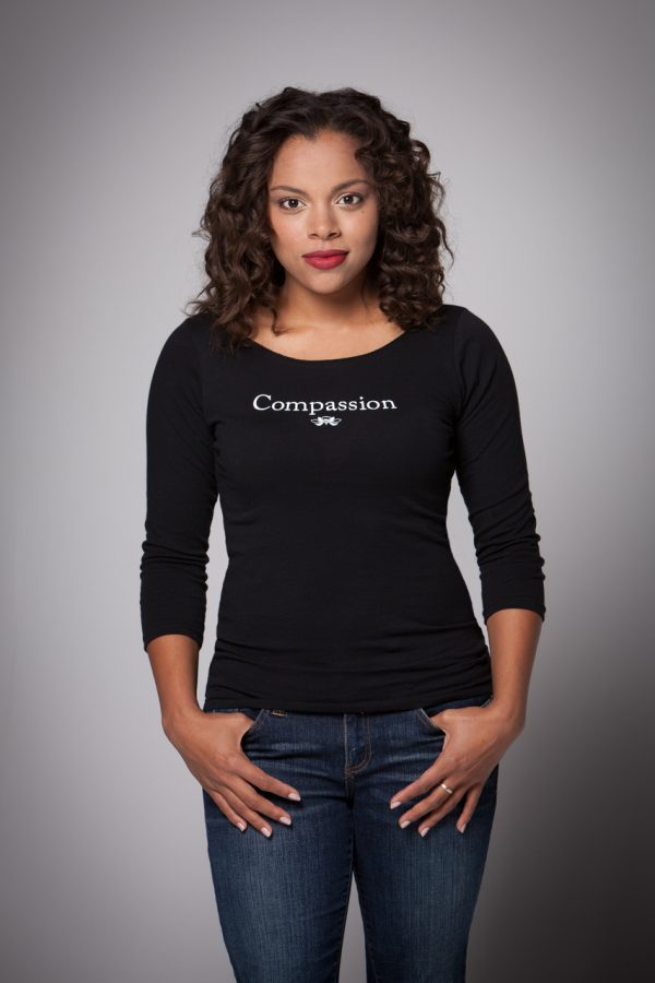 Woman wearing Compassion Boat Neck Shirt