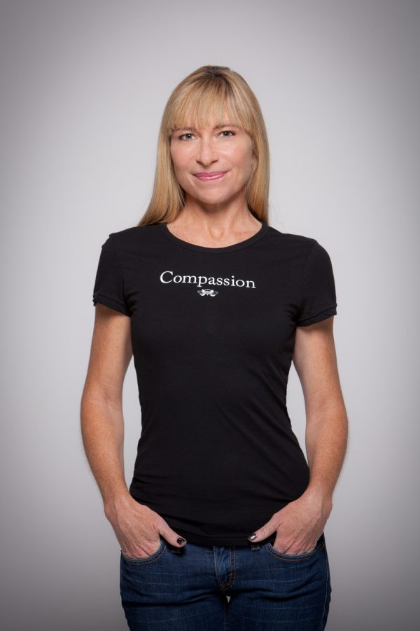 Woman wearing Compassion Cap Sleeve Tee