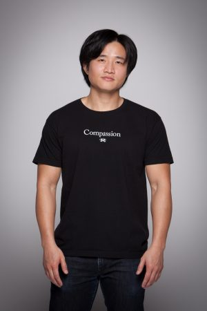 Man wearing Compassion Short Sleeve Tee