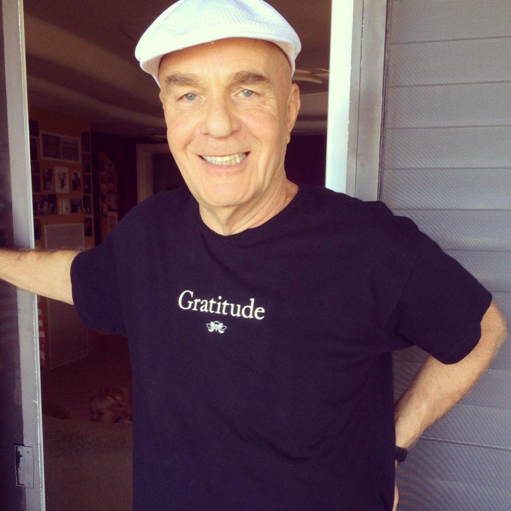 Wayne Dyer wearing Gratitude T-shirt