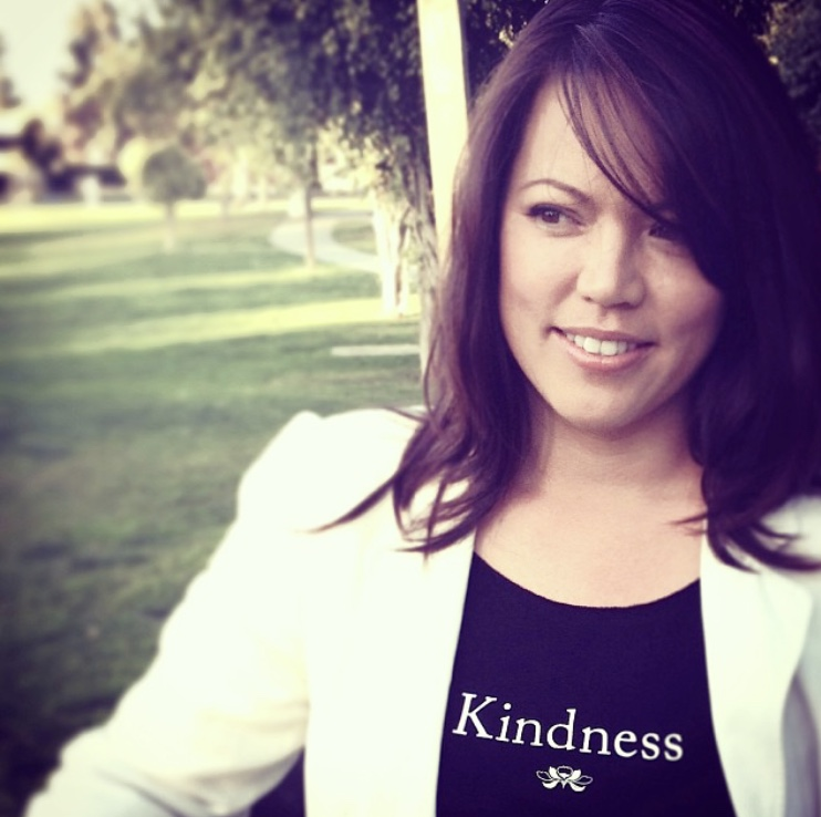Women wearing black Kindness t-shirt