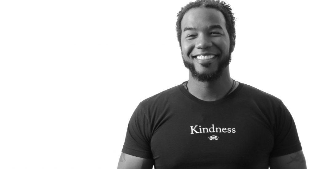 Man wearing black Kindness t-shirt